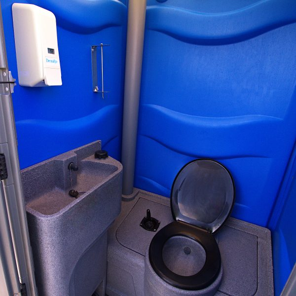 Inside blue construction site portable toilet for hire