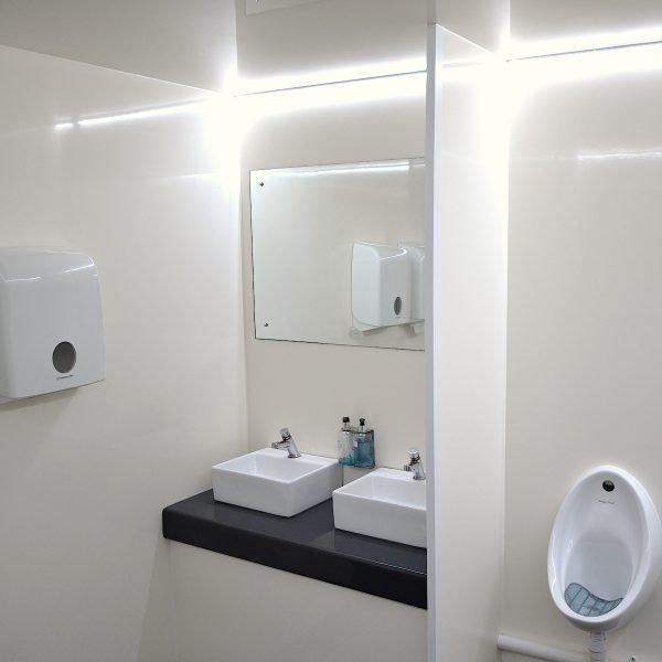 Inside 4+2 Trailer Mounted Toilet trailer for festivals hire