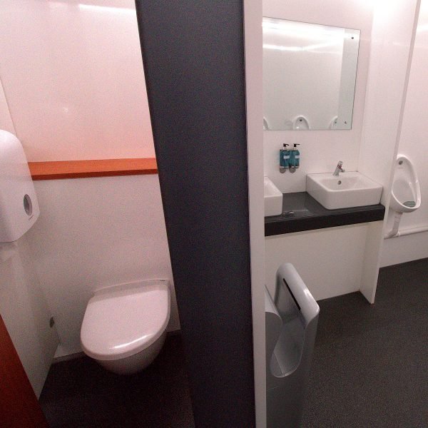 Inside Male 2+7 VACPOD toilet unit for hire to Festivals and Concerts